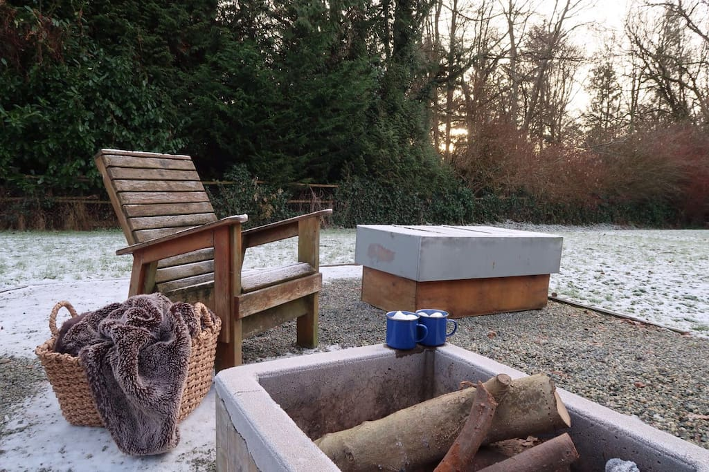 Cozy up to your outdoor wood burning fire pit.