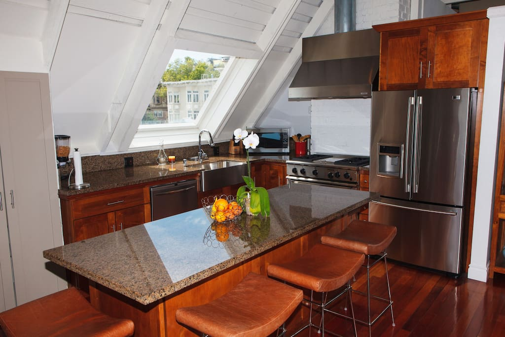 Kitchen including Kitchen Island and 4 gas stoves