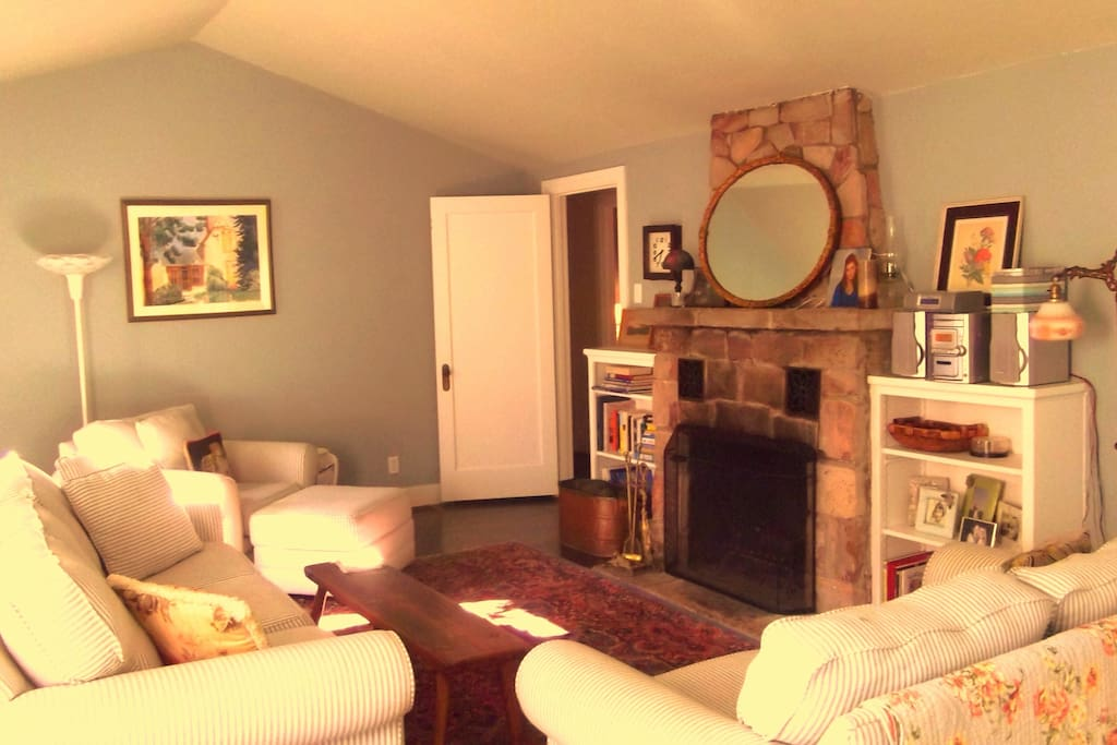The formal living room with a fireplace, a quiet place away from the TV