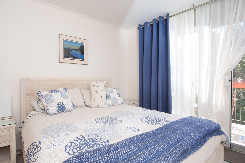 Nice light bedroom with comfortable queen bed
