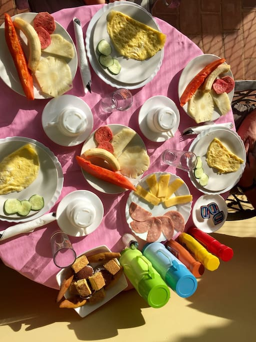 Breakfast :) coffee, milk, fresh fruit juice, eggs in whichever way you like them, fresh fruits, sandwiches, bread, butter, cheese, ham, honey, pastries/cookies...