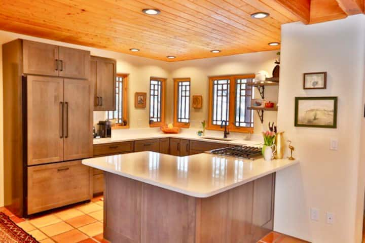 Chic adobe with lux amenities on 2 lush acres
