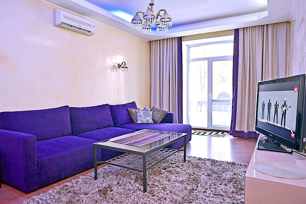 Spacious living room with access to the terrace, overlooking the main street Kreschatik and Independence Square.