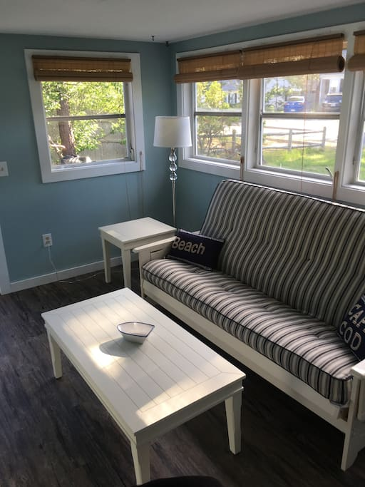 Peaceful sunporch with comfortable queen-sized futon