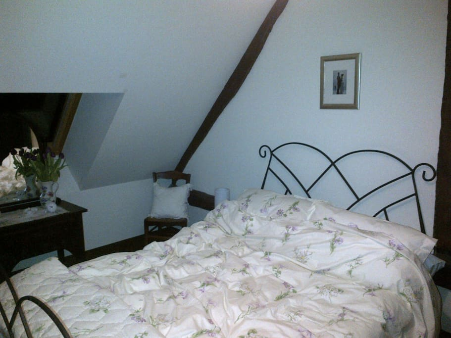 The White Room, on the first floor with space for a cot or single beds for a family. Bathroom adjacent.