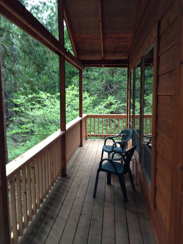 A covered deck to enjoy the outdoors.