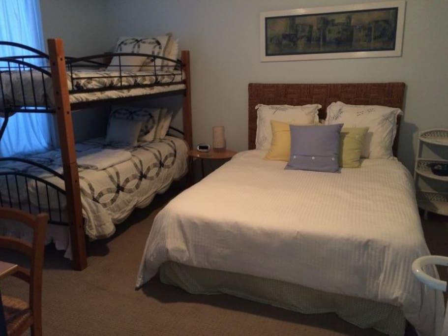 Queen and bunk beds with attached Hall bath