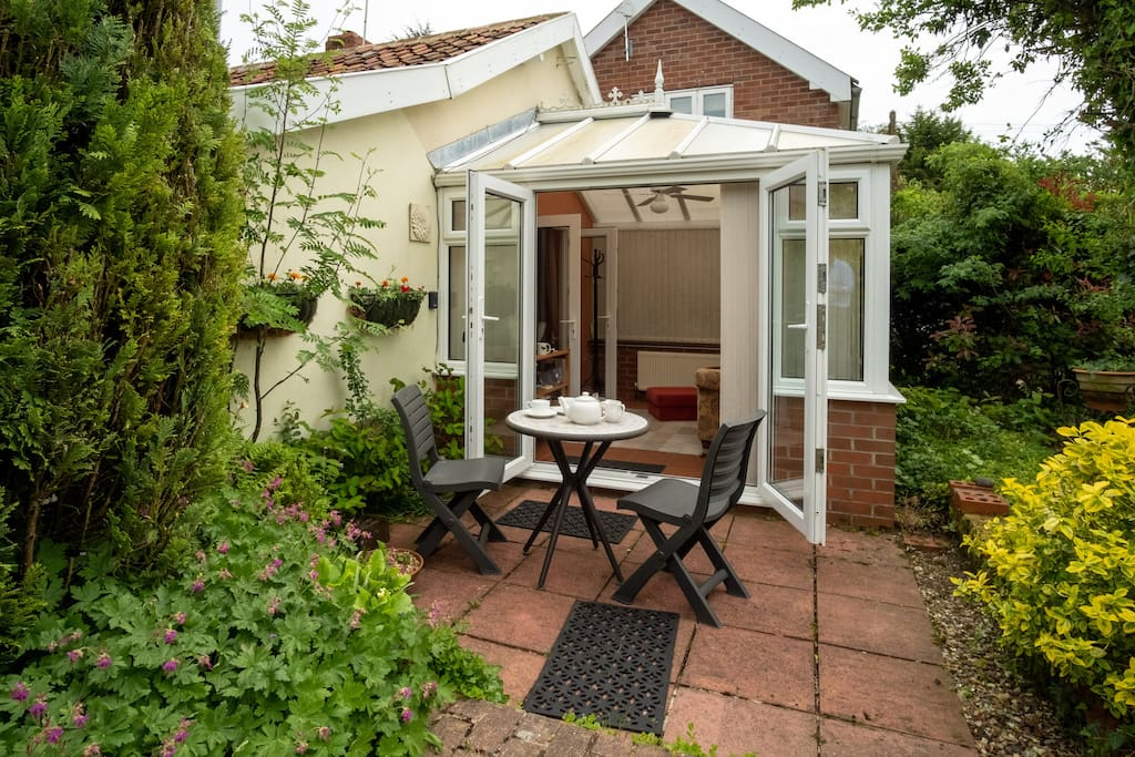 The conservatory opens out into a cottage garden.