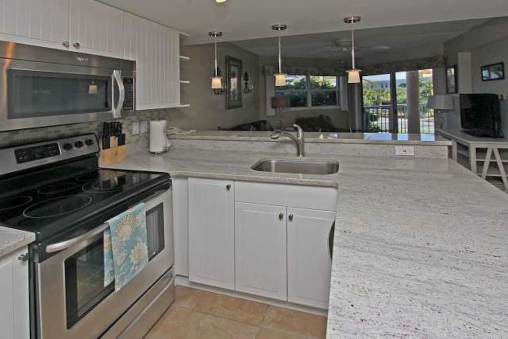 An open kitchen with granite countertops....