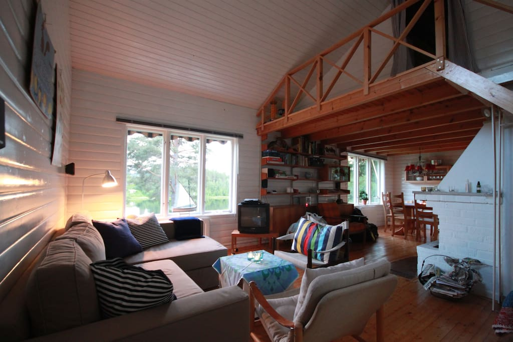 Open plan with living room, kitchen, dining-area and loft.