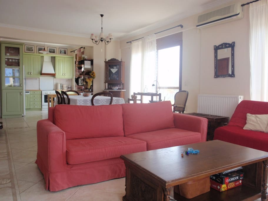 Living room contiguous with dining room and kitchen. There is an excellent view even from the kitchen
