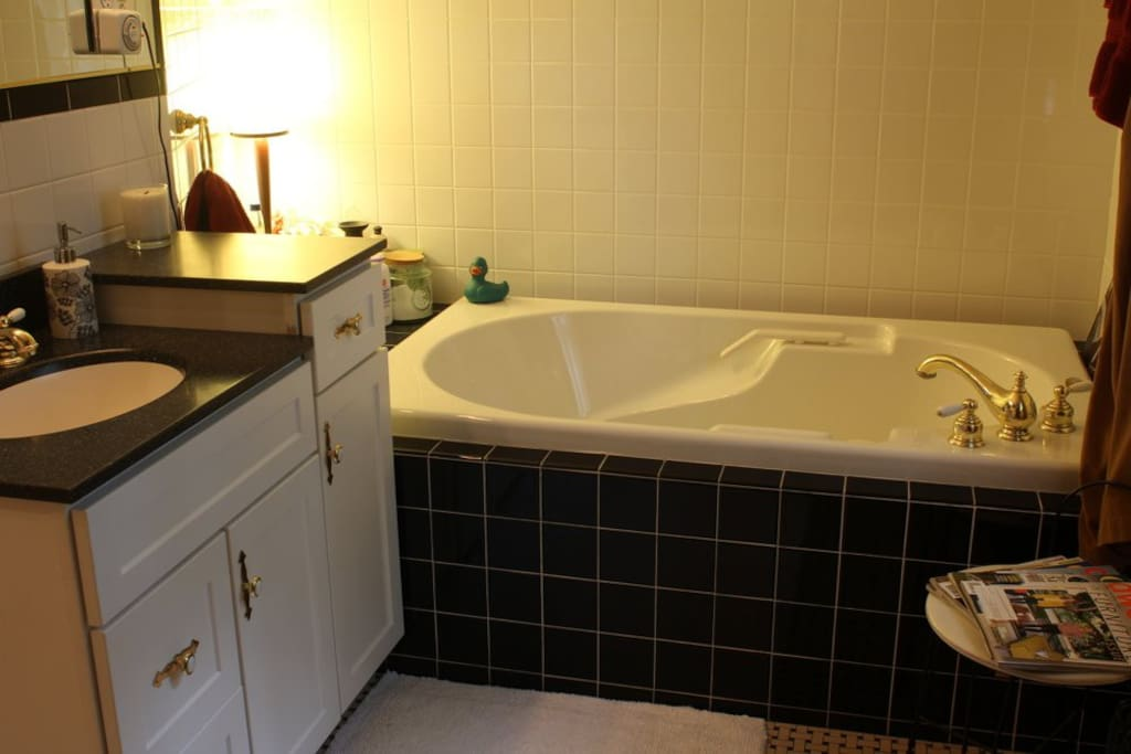 The Private Bath has a large soaking tub and walk-in shower.