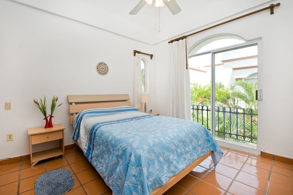 Warm light floods the 2nd bedroom with garden and pool view balcony.  Quiet night's sleep on brand new pillowtop Sealy mattress like sleeping on a cloud.  Quiet as pool closes after dark.  Colonial shaped windows.
