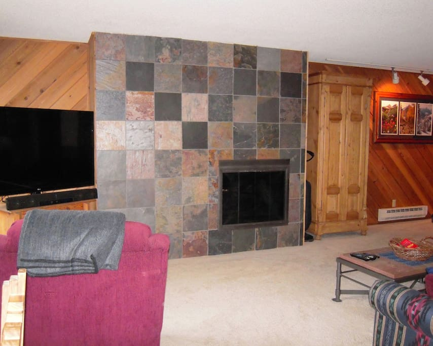 Snugly warm gas fireplace and flat-screen TV. TV includes a Roku player & DVD player