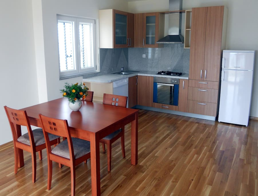 New modern kitchen and dining area.