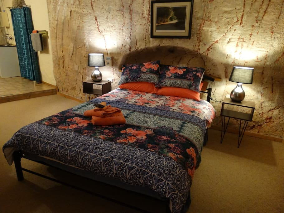 Main bedroom has a queen bed, private shower and toilet.