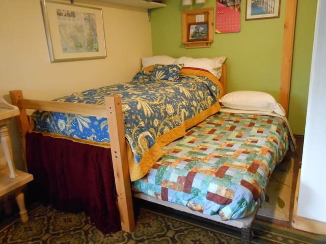 twin bed with trundle will sleep up to two guests
