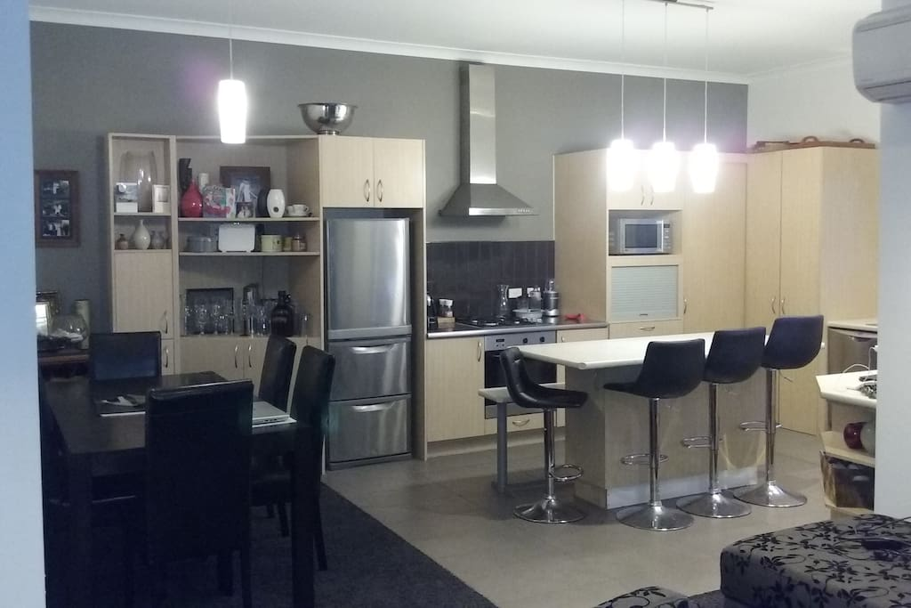 Kitchen dining area, gas stove and breakfast bar.