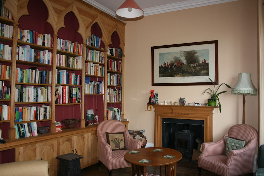 Library for your use with books to browse, music of your choice all in front of a cozy log fire