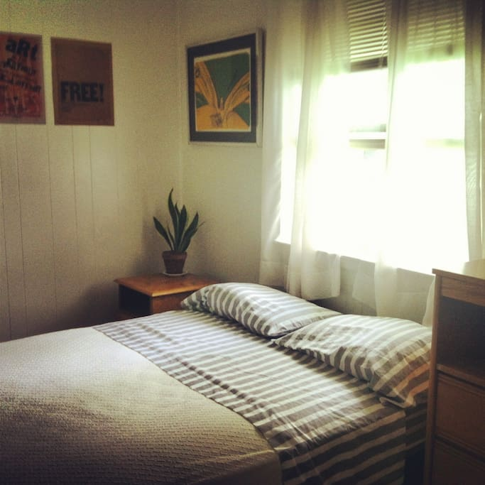 Bedroom 3.  Art and airy!!! Double bed, dresser, desk and side table.  Enjoy the sunlight!