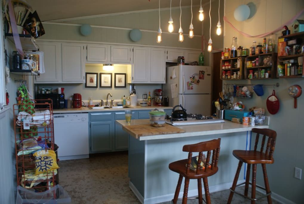 The kitchen is decorated for a birthday party in this picture.  The balloons and streamers have been taken down, but I am pretty sure we have left overs so if you would like to decorate again, you are welcome to!