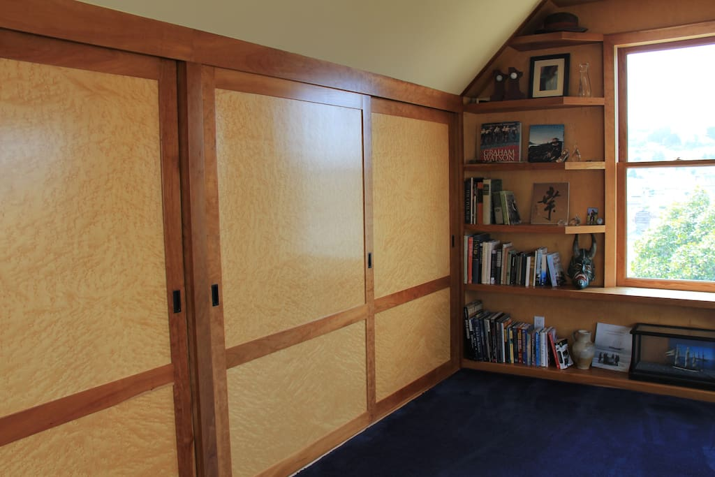 Custom sliding closet doors, built in dressers within.