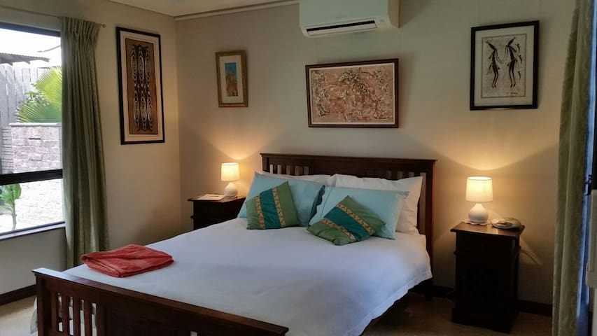 Your master bedroom with Queen size bed and Kimberley art collection.