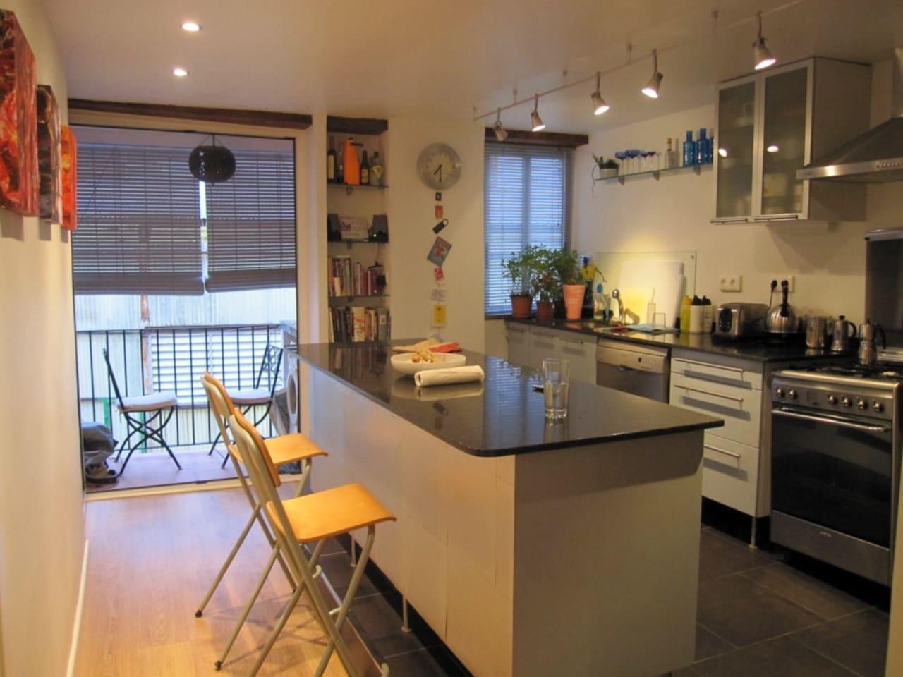 Kitchen / breakfast bar. Rear balcony.