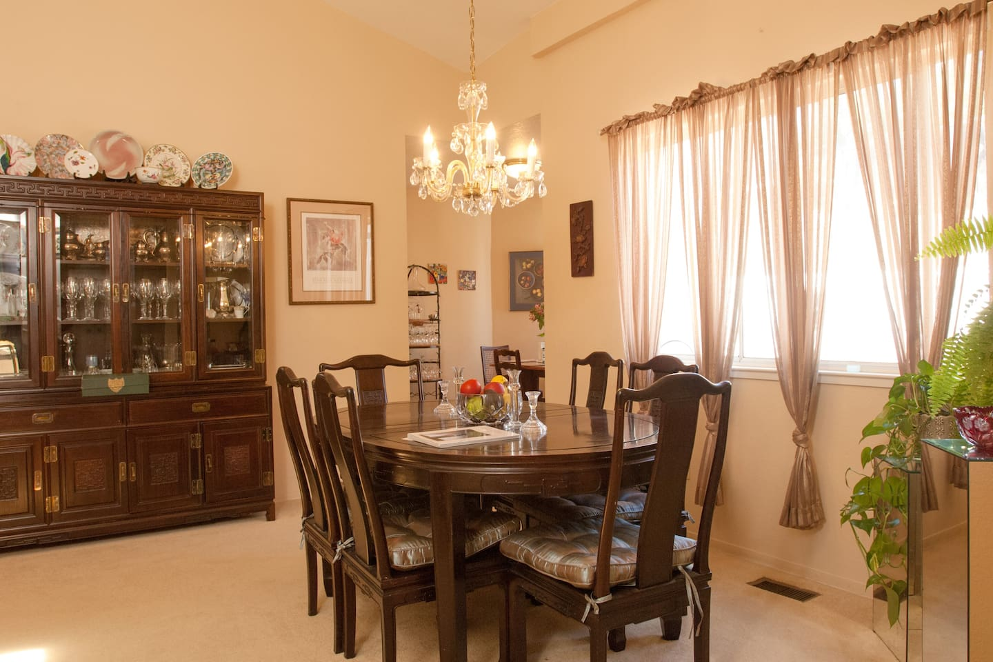 My dad designed the China cabinet and had the table and chairs custom made to match...