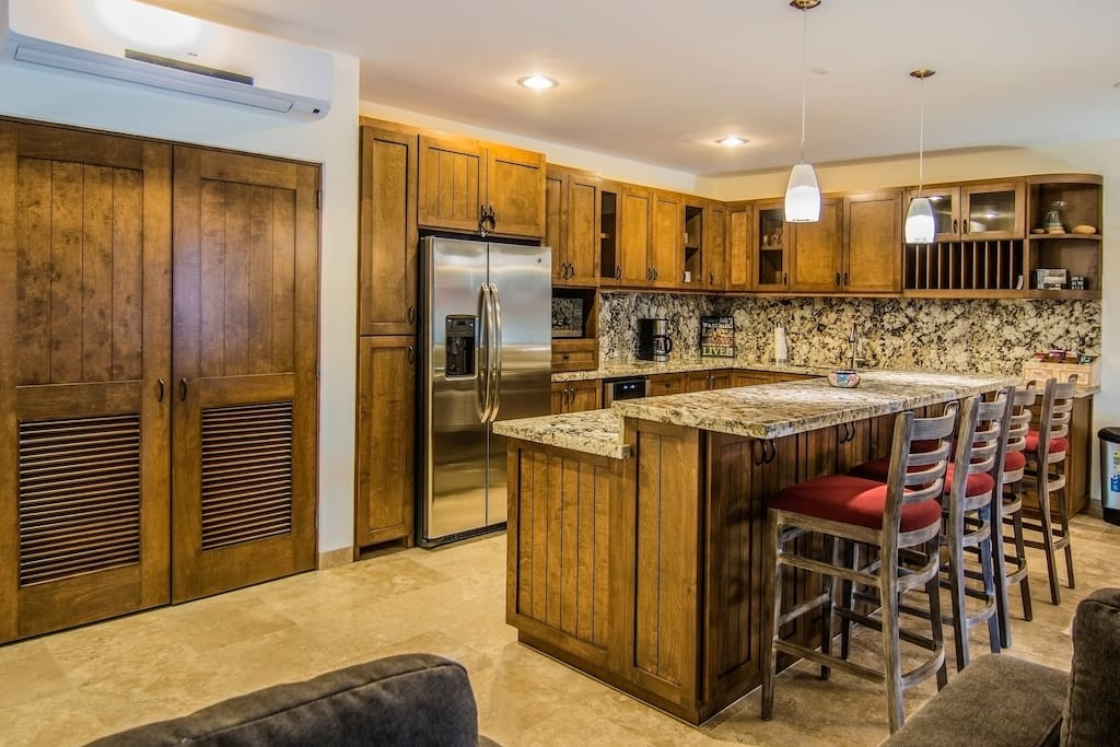 Fully equipped modern kitchen including wine cooler, dishwasher, coffee maker, and gas stove