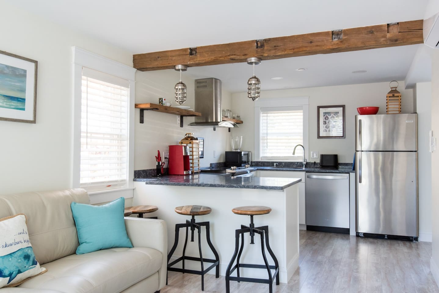 """Rustic sophistication says it all at Kennebunk Coastal Suites #3 unit """" Coveside Suite""""! Original beams add to the overall charm and uniqueness of this suite.  This unit has plenty of room at the counter height bar area for eating & also a dining ta"""