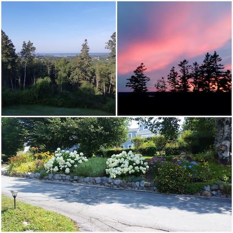 Ocean and sunset views from deck. Property flower garden