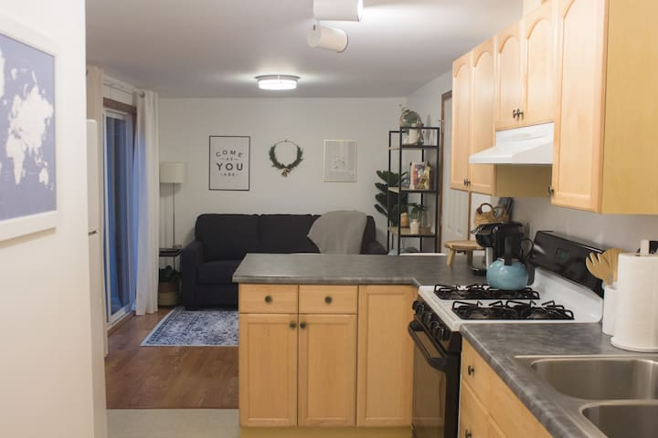 This fully stocked kitchen is ready for whatever you bring back from the downtown farmer's market or the grocery store down the road. Fridge/freezer, gas stove and oven, microwave, double sink. Bring it.