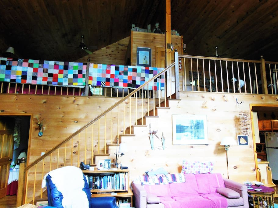 This is the living room showing the staircase leading up to the loft rooms.