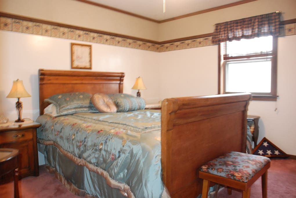 A spacious room with Queen size antique sleigh bed and new pillow top mattress. Full bath is just 4 steps away in hall.