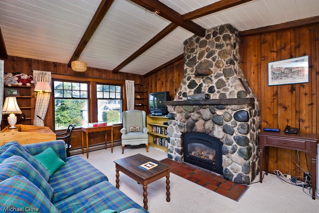 The Living room with Rock gas fireplace and water view off in the distatnce.