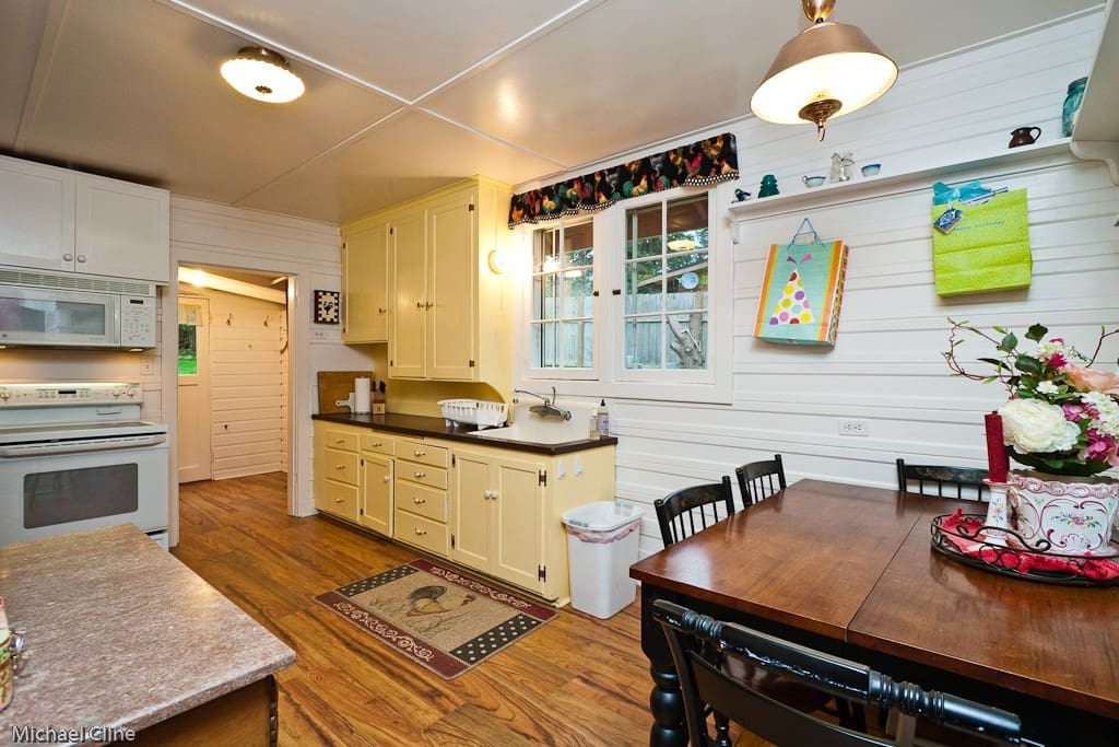 Kitchen with seating for 4, coffee maker, waffle iron, blender & pots n pans