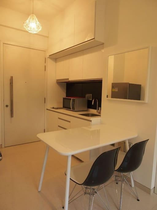 Entrance of door with kitchen and dinning area