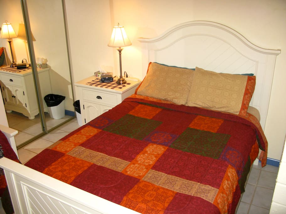 Comfy double and single beds in Canadian Room.