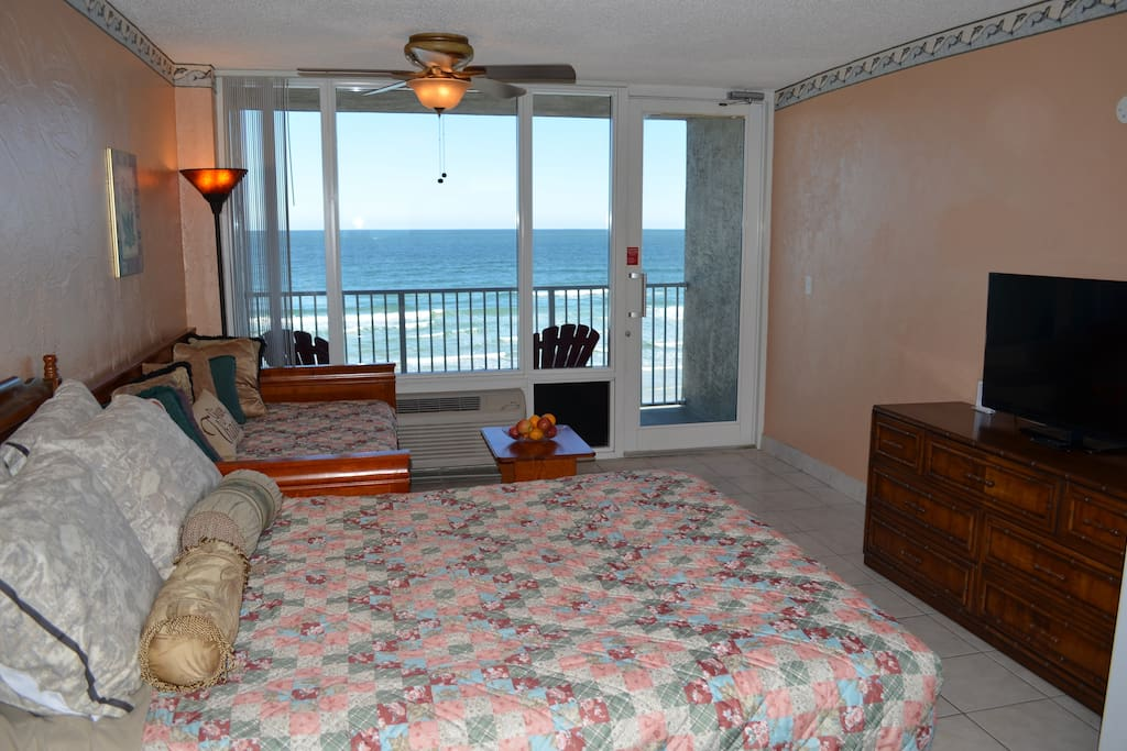 Oceanfront condo with queen size bed and 2 single beds and flatscreen TV with free HBO and Wifi access.