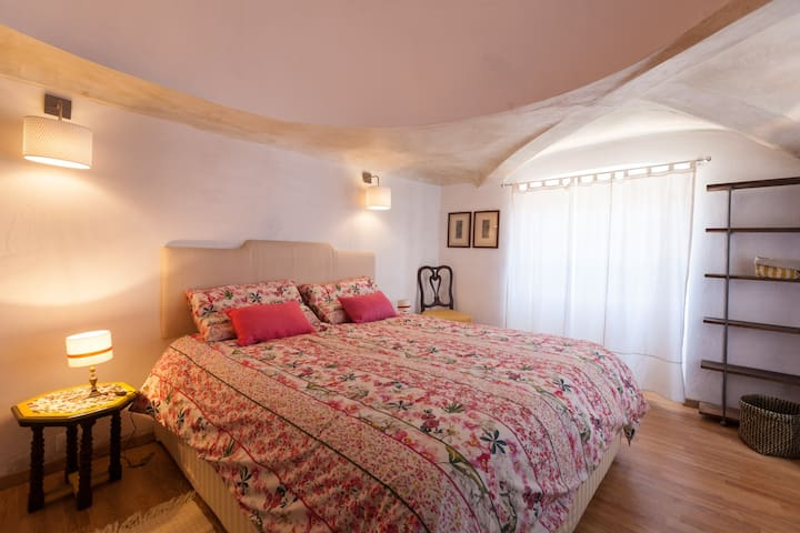 The Bedroom: the comfortable double bed with soft bed-linen