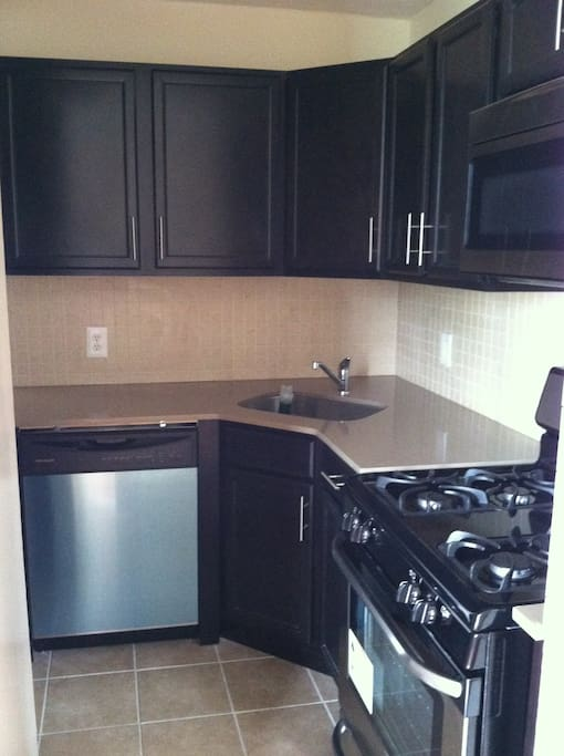 Kitchen has stainless steel appliances and a dishwasher