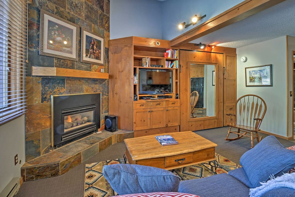 The copper-slate gas-burning fireplace and wood accents create a cozy ambiance.