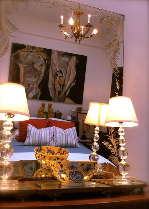 Spacious private room with original artwork, full antique vanity and mirror.