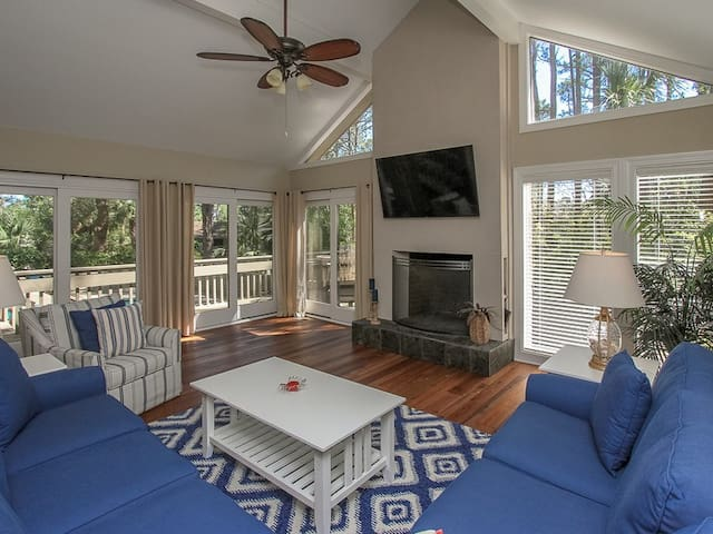 Living Room Surrounded by Windows at 9 Bald Eagle West