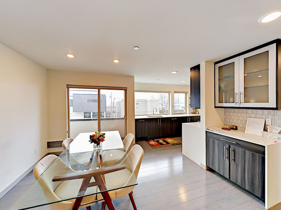Savor home-cooked meals at the 4-person dining table.