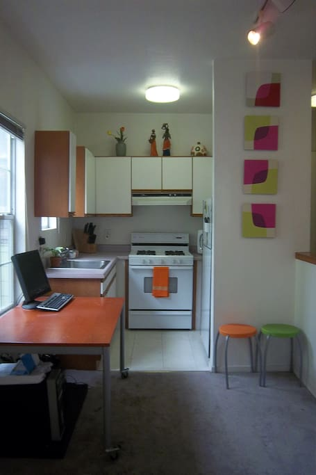 Complete Kitchen with gas range, microwave and refrigeration.