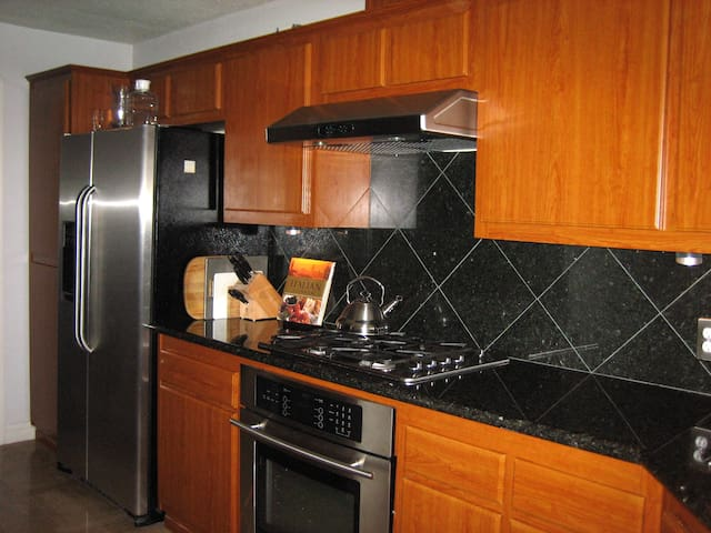 KItchen with Stainless Steel Appliances and Brazillian Granite Countertops and Italian Stone Flooring