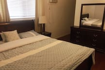 King bed, side table, dresser, AC.