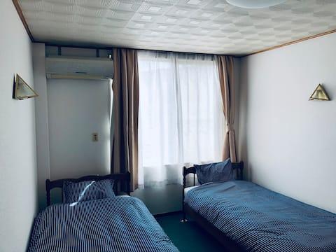 A Bedroom in a Cultural City